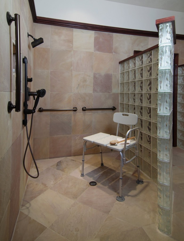 Accessible bathroom with masculine luxury for Pictures of handicap bathrooms