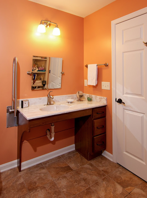 Wheelchair accessible bathroom by bauscher construction for Wheelchair accessible sink bathroom